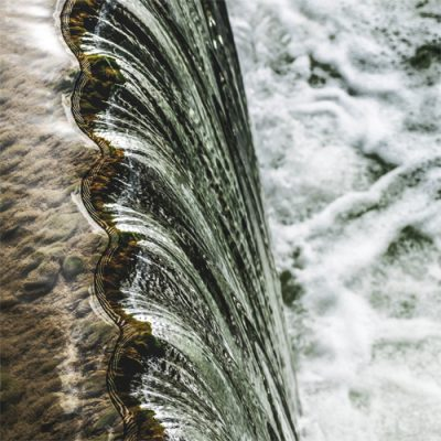 water flowing into a river
