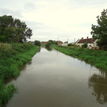running river with houses