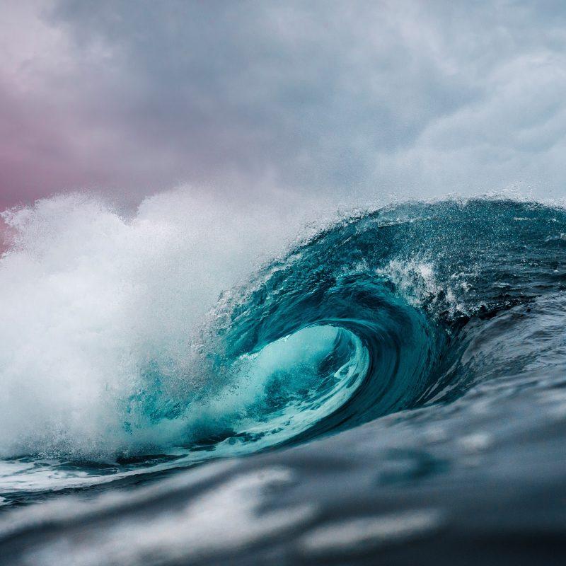 large tidal wave crashing