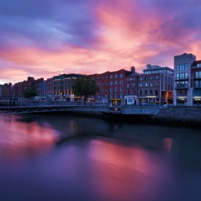 river and buildings with pink sunset